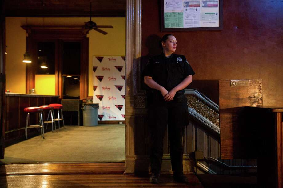 Officer Jessica Potter of the Bear County Protective Services stands by at the entrance of the Bonham Exchange in downtown San Antonio, on Thursday, June 16, 2016. The gay nightclub is increasing its security in the wake of mass shooting in Orlando last weekend. Photo: BRITTANY GREESON /San Antonio Express-News / © 2015 San Antonio Express-News