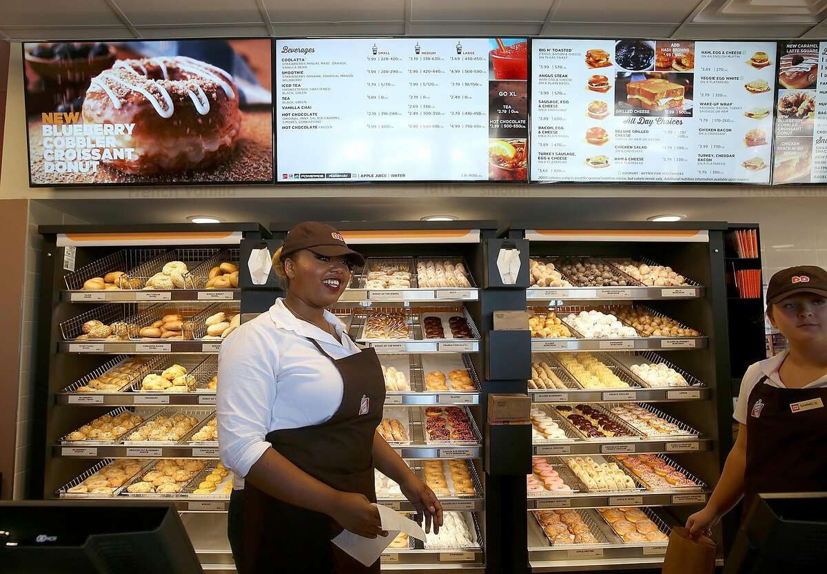 Crew members Blair Stanford (left) and Sammie Berkson (right) work at Dunkin' Donuts during a media preview on Monday, June 20, 2016, in Walnut Creek, Calif.. The Bay Area's very first Dunkin' Donuts shop is opening on Wednesday.