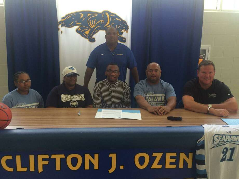 Ozen senior guard John Comeaux signs his letter intent to play basketball at Lamar State-Port Arthur.