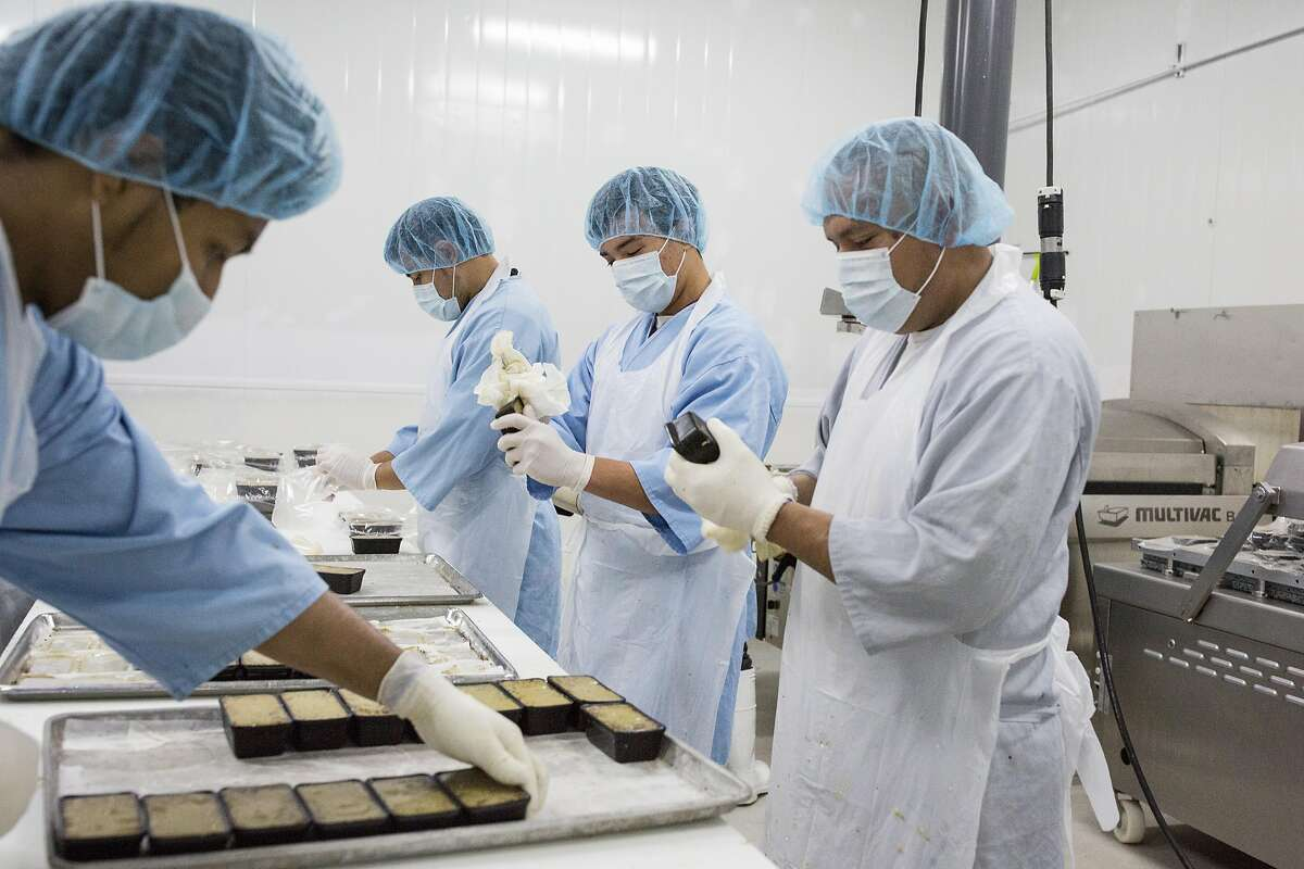 Workers at Fabrique Delices make truffle mousse at the company's headquarters in Hayward, Calif., on Monday, June 13, 2016. The traditional French charcuterie company makes products such as duck confit and sausage.
