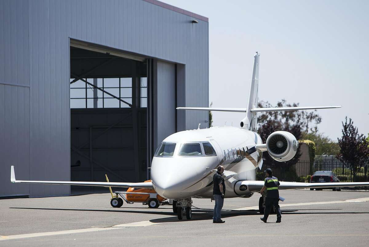 A jet is prepared for take off before departing the Hayward Executive Airport in Hayward.
