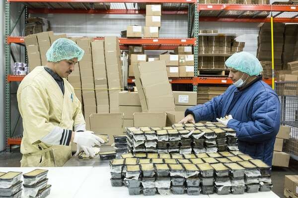 Workers package truffle mousse and prepare it for shipment at Fabrique Delices in Hayward, Calif., on Monday, June 13, 2016. The traditional French charcuterie company makes products such as duck confit and sausage.