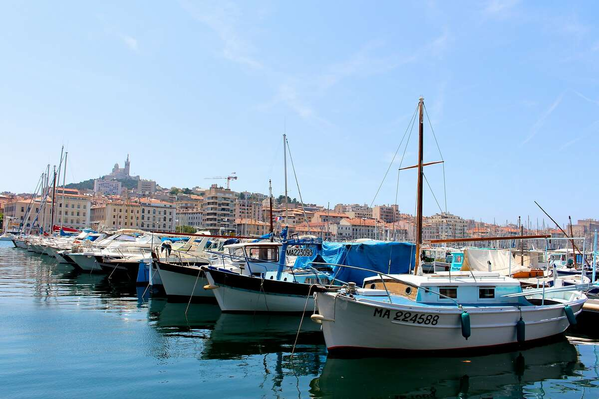 Eye-level with the boats at Marseille�s Vieux Port. In the background, the Notre-Dame de la Garde crown the highest hill in the city.
