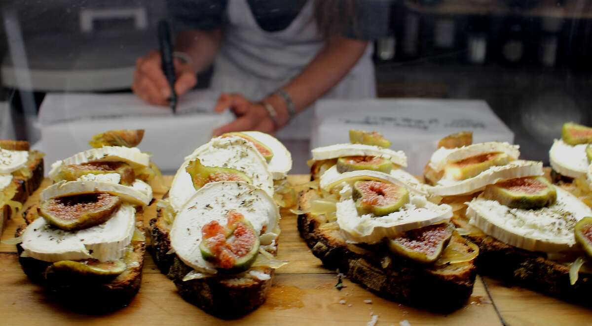 Farm-fresh sliced fig and goat cheese sandwiches at Marche Saint-Victor.