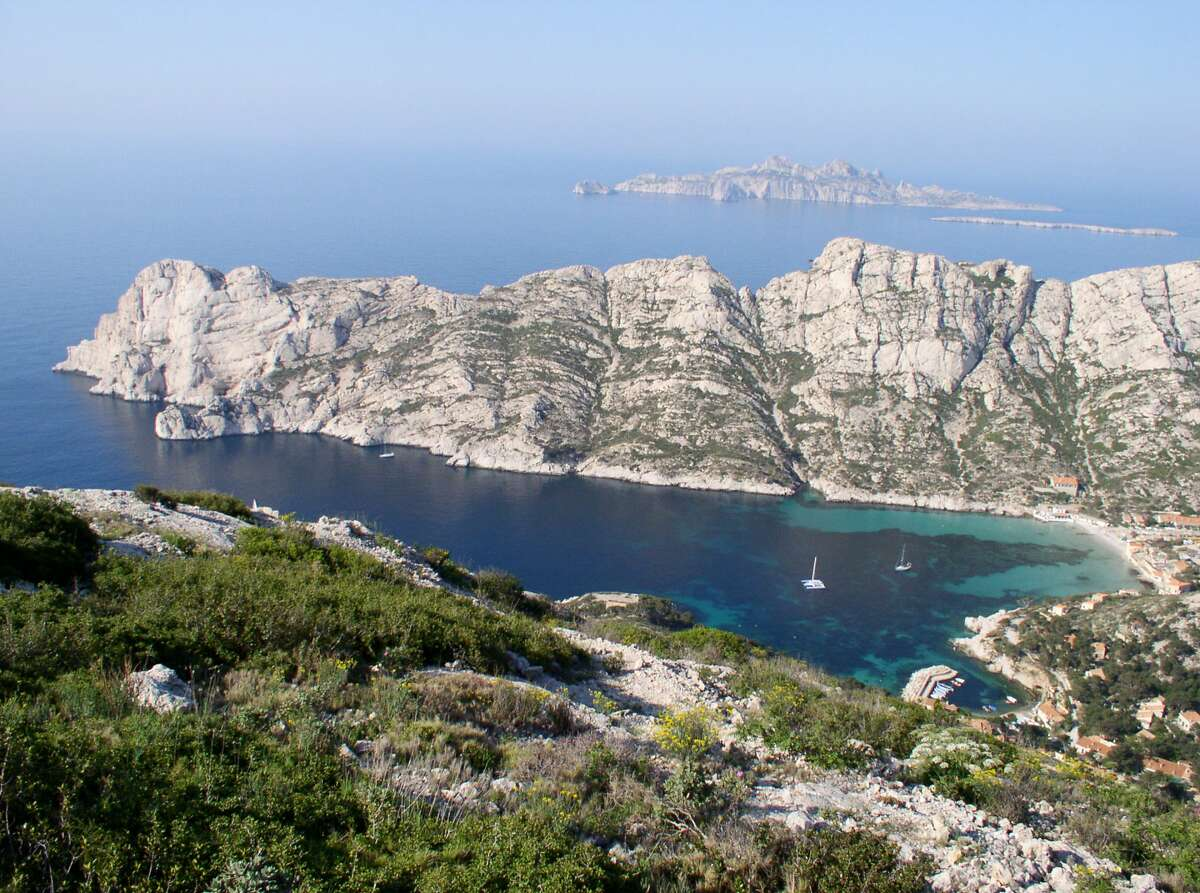 The cobalt Cotes d'Azur shimmers against the rugged cliffs at Calanques National Park.