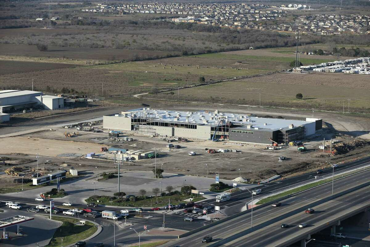 In this Feb. 18 photo, work continues at an H-E-B Plus under construction at the corner of FM 306 and Interstate 35 in New Braunfels. State records show construction cost an estimated $14 million.