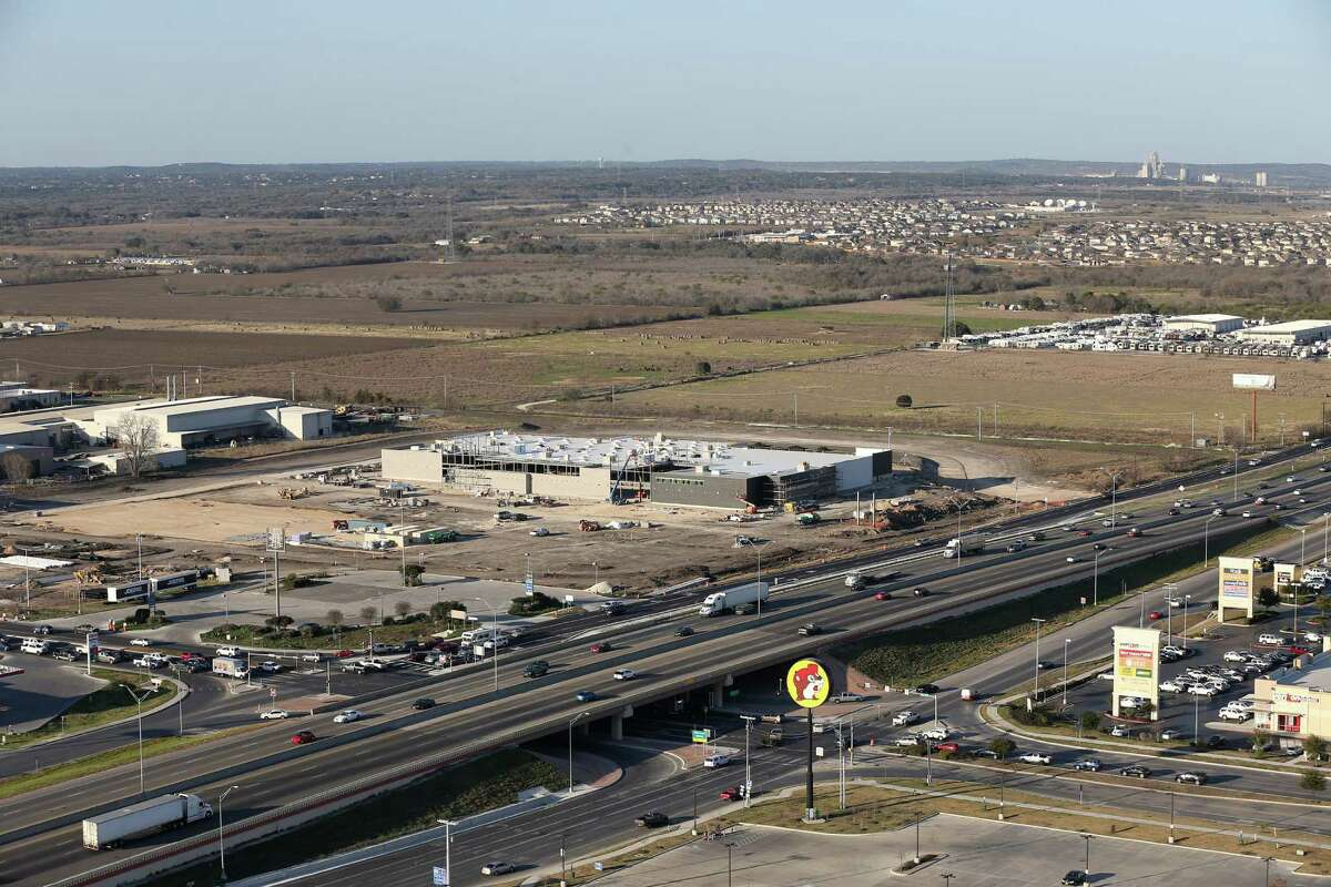 An H-E-B Plus slated to open Friday in New Braunfels will feature a gas station, automated car wash and a drive-thru pharmacy. In this Feb. 18 photo, work continues on the site.