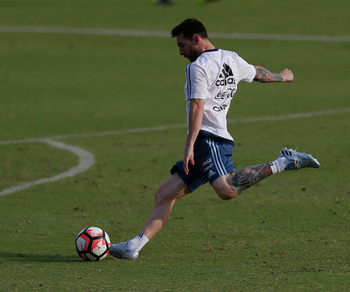 Lionel Messi kicks a ball during the Argentina men's soccer practice at Rice University, Monday, June 20, 2016, in Houston, as they prepare to face the US, Tuesday night.