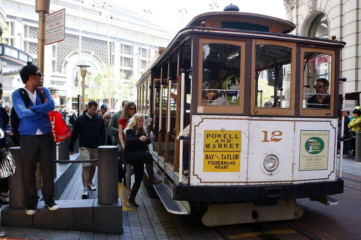 Visitors and tourists board the historic San Francisco cable cars at the Market and Powell Street cable car stop in San Francisco Calif., on June 7, 2011. A single ride on the cable cars will cost six dollars to ride starting next month.