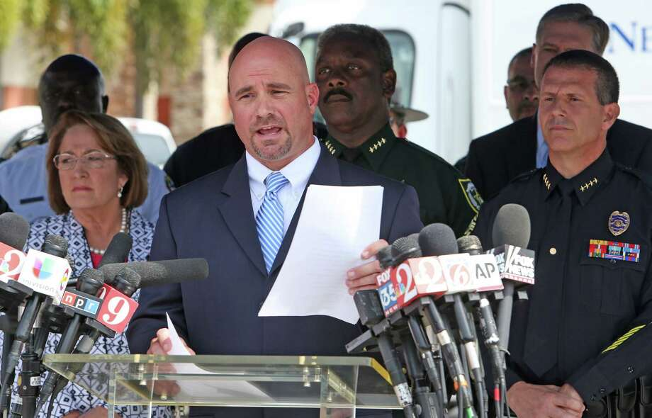 "FBI Special Agent Ron Hopper, center, talks to the media during a press briefing Monday, June 20, 2016, near the Pulse Nightclub shooting scene in Orlando, Fla. Orlando gunman Omar Mateen identified himself as an Islamic soldier in calls with authorities during his rampage and demanded to a crisis negotiator that the U.S. ""stop bombing Syria and Iraq,"" according to transcripts released by the FBI on Monday.   (Red Huber/Orlando Sentinel via AP) ORG XMIT: FLORL106 Photo: Red Huber / Orlando Sentinel"