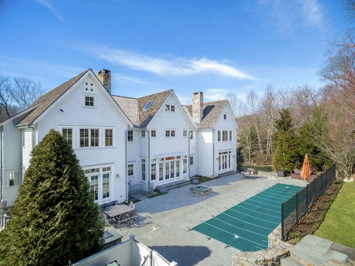The hilltop estate at 64 Lyons Plains Road is an ideal retreat for sports enthusiasts and those who enjoy relaxation and entertaining guests.