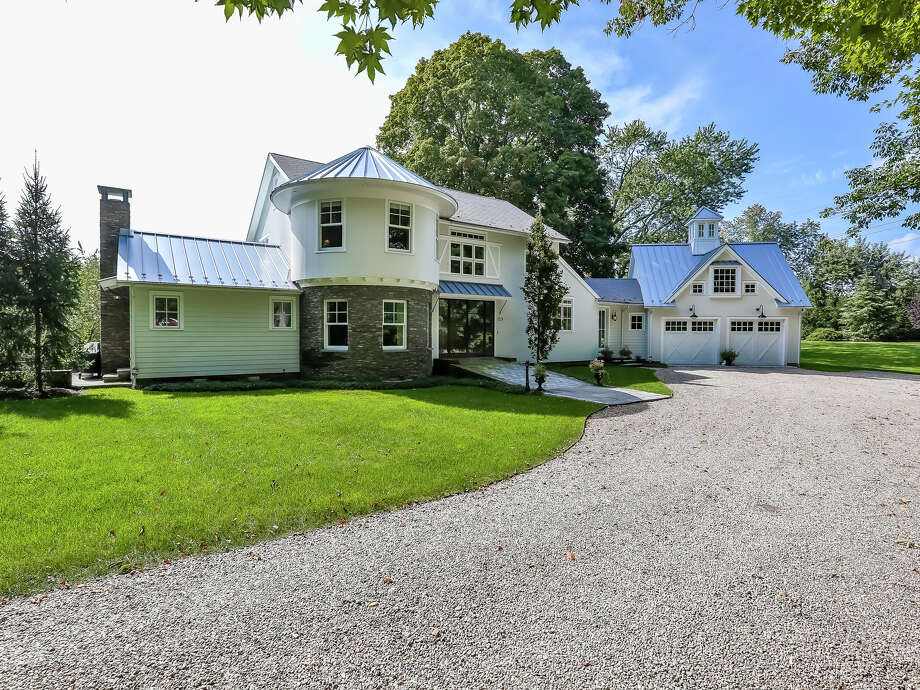 This Southport home, on the market for $2,399,000, is a replica of the orginal onion farm barn that was once on the site. Photo: Meg Barone / For Hearst Connecticut Media / Fairfield Citizen