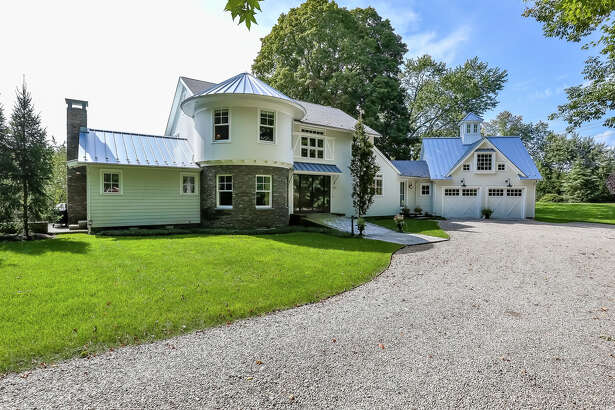 This Southport home, on the market for $2,399,000, is a replica of the orginal onion farm barn that was once on the site.