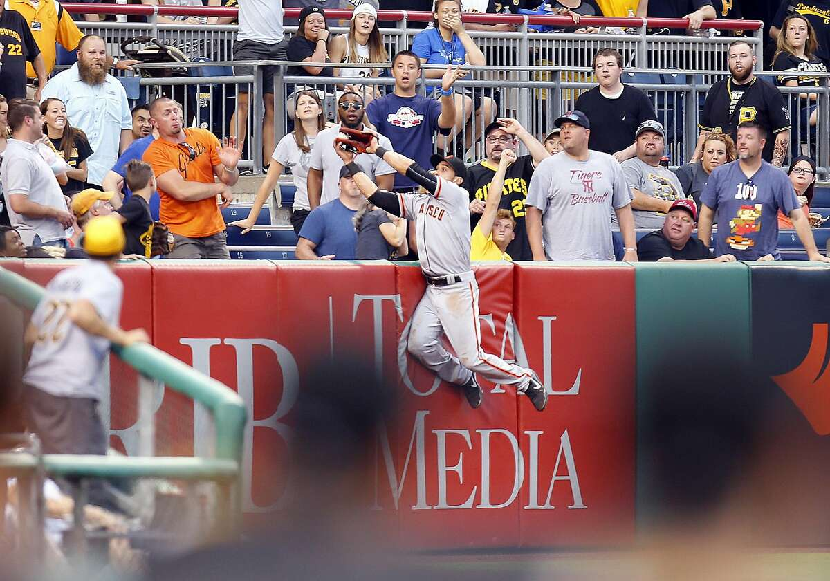 PITTSBURGH, PA - JUNE 20: Angel Pagan #16 of the San Francisco Giants can't make the catch on a home run by Erik Kratz #38 of the Pittsburgh Pirates (not pictured) in the fifth inning during the game at PNC Park on June 20, 2016 in Pittsburgh, Pennsylvania. (Photo by Justin K. Aller/Getty Images)