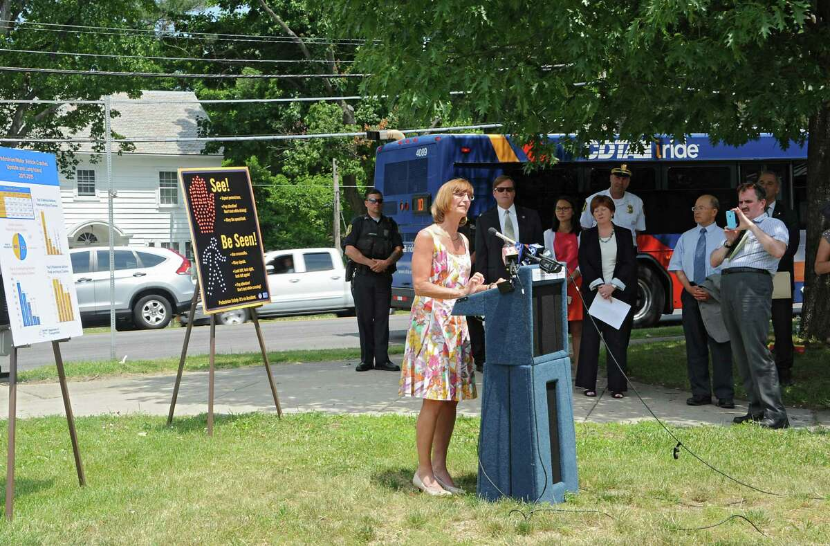 New York State Department of Motor Vehicles Executive Deputy Commissioner Terri Egan speaks as state DOT employees and other officials talked about pedestrian safety at a new pedestrian signal at Western Avenue and Russell Road during a press conference near Eagle Point Elementary School on Monday, June 20, 2016 in Albany, N.Y. (Lori Van Buren / Times Union)