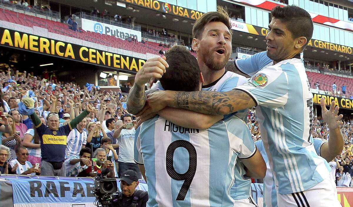 Gonzalo Higuain (9) of Argentina celebrates his goal with Lionel Messi (middle) and Ever Banega (right) in the first half during the 2016 Copa America Centenario quarterfinal match against Venezuela at Gillette Stadium on June 18, 2016 in Foxboro, Mas.