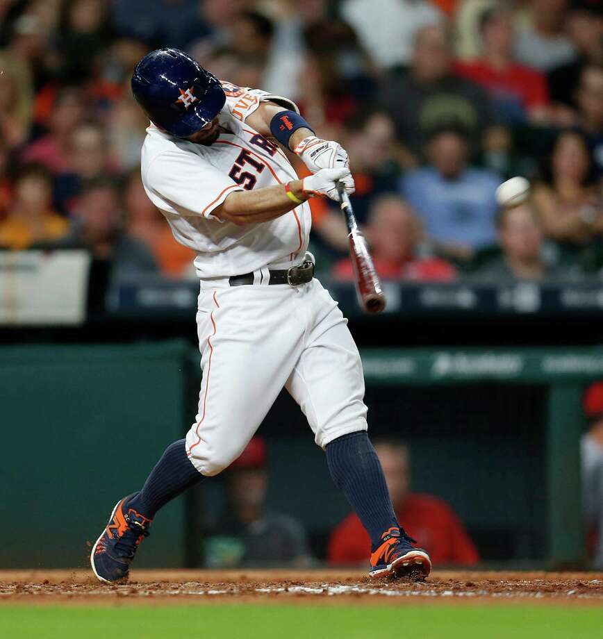 June 20: Astros 10, Angel 7Houston Astros second baseman Jose Altuve (27) hits a home run during the fourth inning of an MLB baseball game at Minute Maid Park, Monday, June 20, 2016, in Houston. Photo: Karen Warren, Houston Chronicle / © 2016 Houston Chronicle
