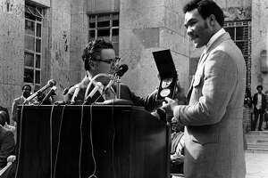 George Foreman, who won an Olympic gold medal in 1968, receives a special award from Mayor Louie Welch after winning the heavyweight title in 1973.