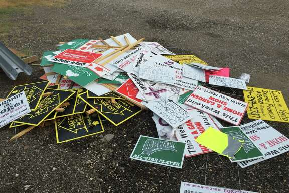 """Between 2008 and 2011, volunteers retrieved hundreds of """"bandit"""" signs similar to these that had been posted along rights of way on FM 1960.     Between 2008 and 2011, volunteers retrieved hundreds of """"bandit"""" signs similar to these that had been posted along rights of way on FM 1960."""