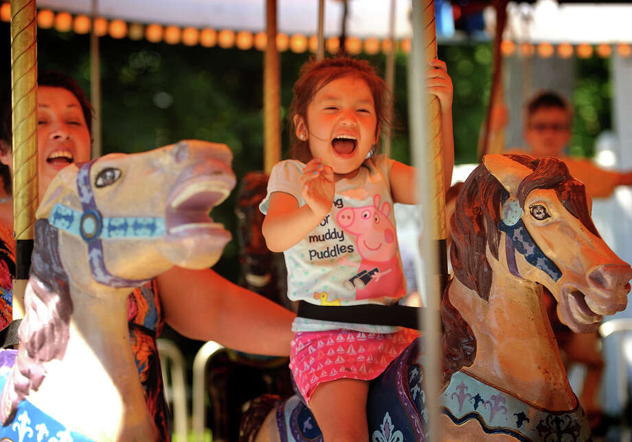 Kamilla Henriquez, 3, gets excited as she rides the carousel with her grandmother, Rebecca Richeme, both of Norwalk, at the annual Yankee Doodle Fair at the Westport Women's Club at 44 Imperial Avenue in Westport, Conn, on Sunday, June 19, 2016. Photo: Brian A. Pounds / Hearst Connecticut Media / Connecticut Post