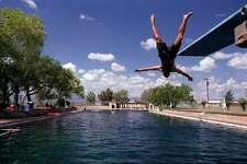 A visitor takes the plunge into San Solomon Springs pool at Balmorhea State Park near Toyahvale, Texas. The 25-–foot-deep pool is fed the natural spring at a rate of 22-–26 million gallons daily.  (Photo by Bryan Chan/Los Angeles Times via Getty Images)