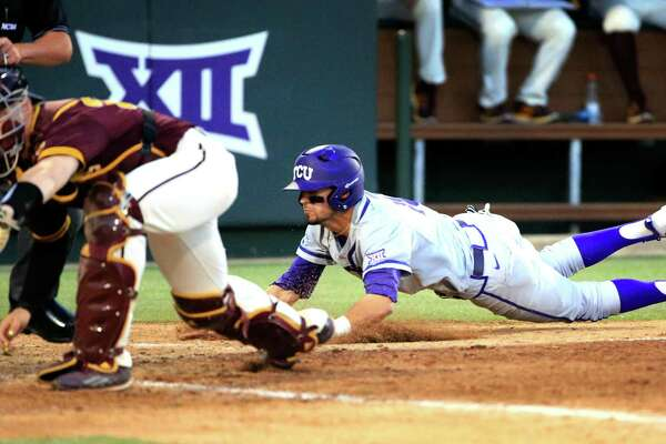 TCU outfielder Dane Steinhagen, right, dives head first to home plate to score behind Arizona State catcher Brian Serven, left, in the eight inning of an NCAA college baseball regional tournament game in Fort Worth, Texas, Sunday, June 5, 2016. TCU won 8-1. (AP Photo/Ron Jenkins)