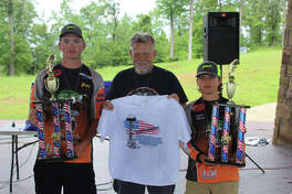 Champions Hunter Moncrief and Landen McCary with Terry Sympson photo Terry Sympson