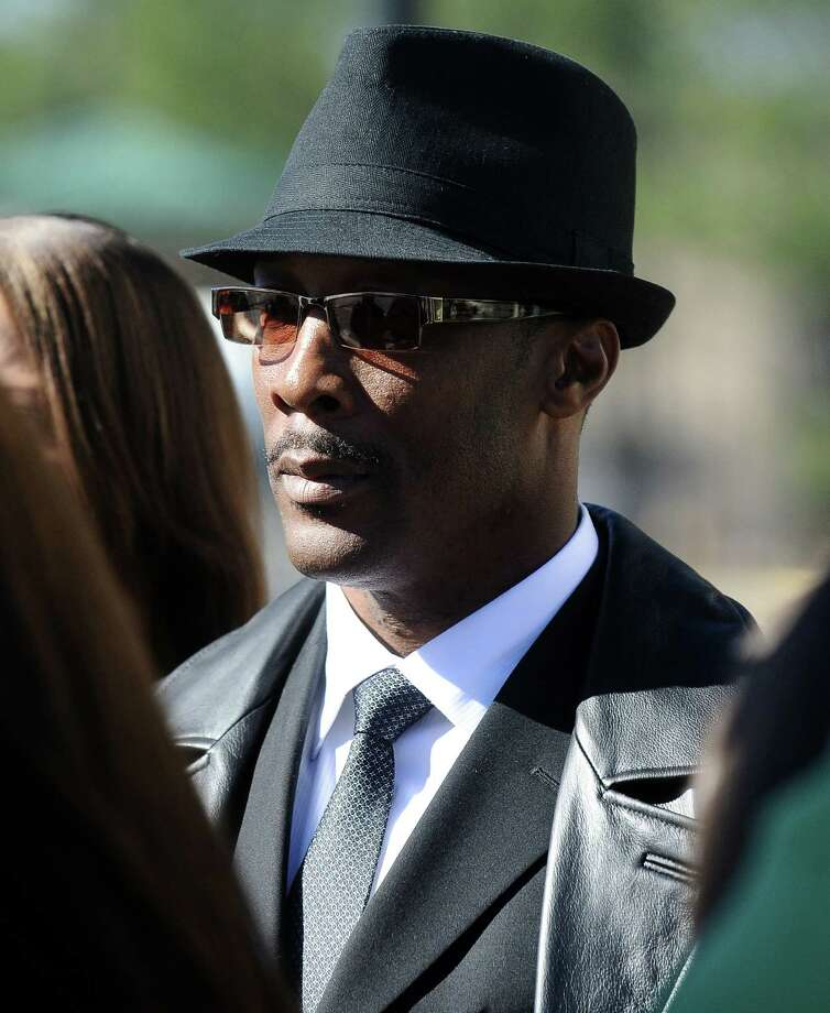 Beaumont ISD's former electrician of record Calvin Walker makes his way out of the Jack Brooks Federal Courthouse on Wednesday, December 12, 2012.   Photo taken: Randy Edwards/The Enterprise Photo: Randy Edwards