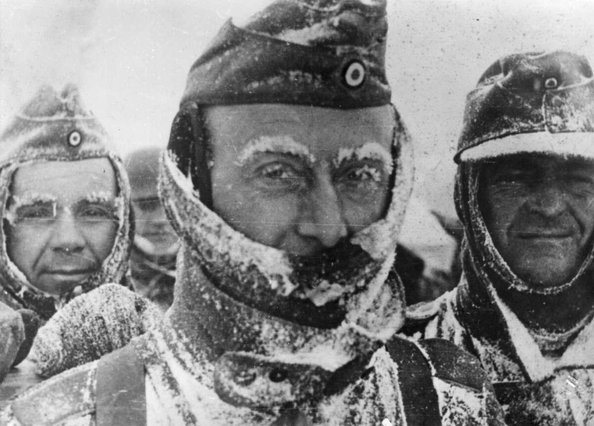 27th March 1944: Three German soldiers covered in snow and ice during winter on the Eastern front. (Photo by Hulton Archive/Getty Images)