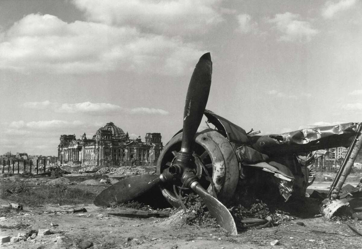 Close up of the scraps of the German fighter 'Focke-Wulf' among the ruins in a meadow in Tiergarten park, behind the Reichstag. Berlin, May 1945. (Photo by Mondadori Portfolio via Getty Images)