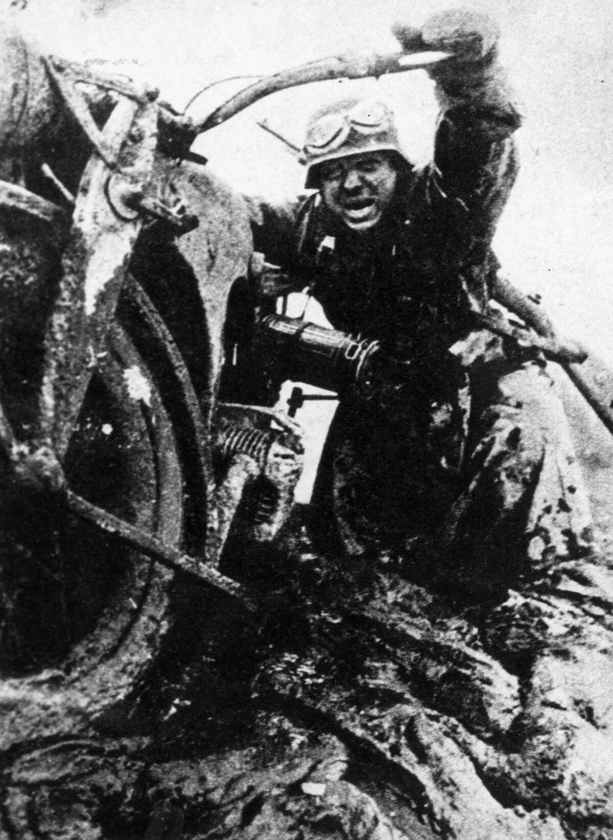November 1941: A German despatch rider is bogged down in the mud on a Russian battlefield after continuous rainfall. (Photo by Keystone/Getty Images)