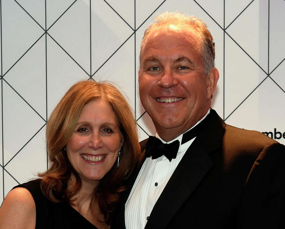 "Alexander ""Alex"" Dimitrief, senior vice president and general counsel at General Electric (GE) Capital, and Jill Dimitrief stand for a photograph during the Bloomberg cocktail party before the White House Correspondents' Association (WHCA) Dinner in Washington, D.C., U.S., on Saturday, April 30, 2016. The 102nd WHCA raises money for scholarships and honors the recipients of the organization's journalism awards. Photo: File Photo / © 2016 Bloomberg Finance LP"