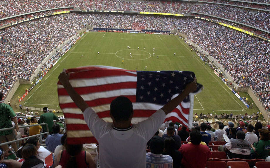 """A fan waves an American flag before the start of the game as the National Teams of the U.S.A and Mexico square off in a """"friendly"""" soccer match at Reliant Stadium in Houston, Thursday evening, May 8, 2003.    (Joshua Trujillo/Chronicle) ***CORRECTED CAPTION***     HOUCHRON CAPTION (03/15/2005) SECSPTS COLOR:  CROWD CONTROL: After 69,582 fans saw the United States-Mexico game in 2003, expectations were high for soccer in Houston. But every now and then at Reliant and other venues, fans find themselves surrounded by empty seats, something promoters are determined to address. Photo: JOSHUA TRUJILLO, HOUSTON CHRONICLE / HOUSTON CHRONICLE"""