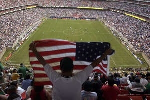"A fan waves an American flag before the start of the game as the National Teams of the U.S.A and Mexico square off in a ""friendly"" soccer match at Reliant Stadium in Houston, Thursday evening, May 8, 2003.    (Joshua Trujillo/Chronicle) ***CORRECTED CAPTION***     HOUCHRON CAPTION (03/15/2005) SECSPTS COLOR:  CROWD CONTROL: After 69,582 fans saw the United States-Mexico game in 2003, expectations were high for soccer in Houston. But every now and then at Reliant and other venues, fans find themselves surrounded by empty seats, something promoters are determined to address."