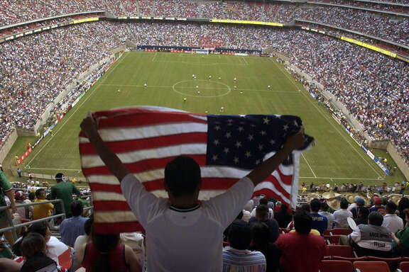 """A fan waves an American flag before the start of the game as the National Teams of the U.S.A and Mexico square off in a """"friendly"""" soccer match at Reliant Stadium in Houston, Thursday evening, May 8, 2003.    (Joshua Trujillo/Chronicle) ***CORRECTED CAPTION***     HOUCHRON CAPTION (03/15/2005) SECSPTS COLOR:  CROWD CONTROL: After 69,582 fans saw the United States-Mexico game in 2003, expectations were high for soccer in Houston. But every now and then at Reliant and other venues, fans find themselves surrounded by empty seats, something promoters are determined to address."""