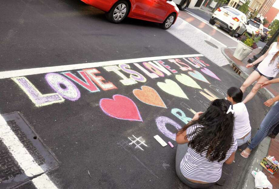 Student members of the Center for Youth Leadership chalked Washington Street in SoNo to show support for LGBT victims involved in the Orlando, Fla. shooting. Photo: Contributed Photo