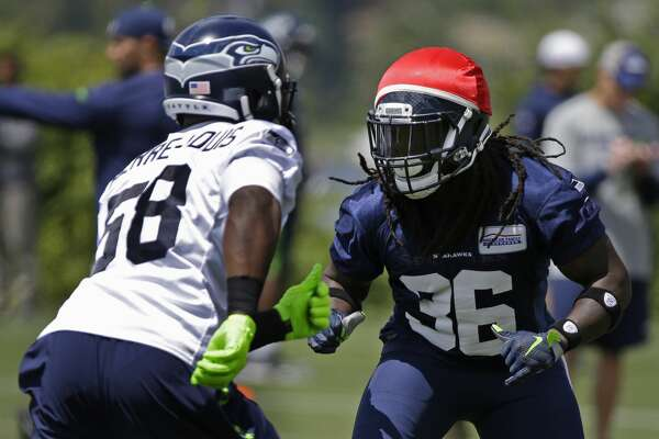 Seattle Seahawks' rookie running back Alex Collins (36) squares off against linebacker Kevin Pierre-Louis, left, during NFL football practice, Wednesday, June 15, 2016, in Renton, Wash. (AP Photo/Ted S. Warren)