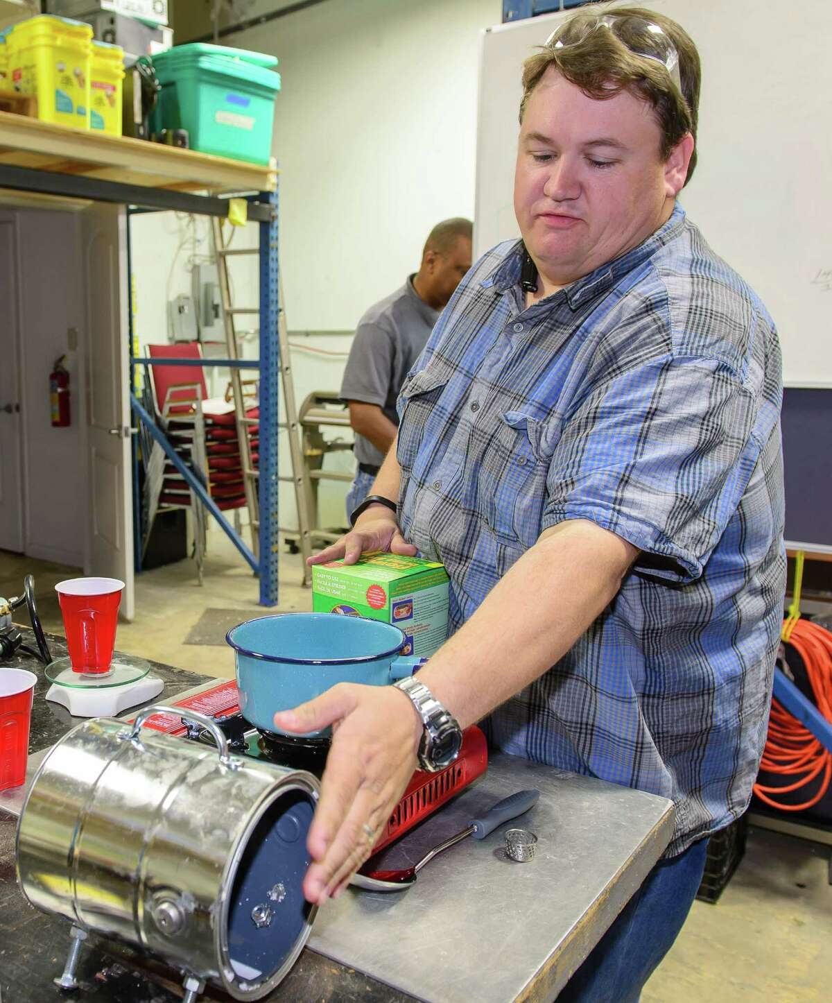 Creatorspace member Ryan Erskine creates high-temperature glue at the creative/tech cooperative workshop.