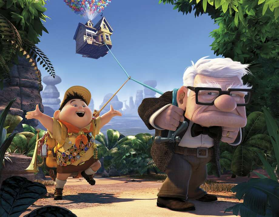 "Russell, left, and Carl Fredricksen are shown in a scene from the film, ""Up."" Photo: AP"