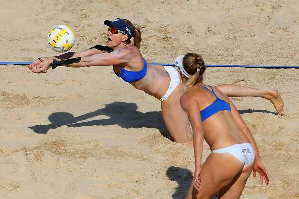 feec343f14 1of13Kerri Walsh Jennings dives for the ball as April Ross looks on against  Lane Carico and Summer Ross during the Women's AVP New York Open  Championship ...