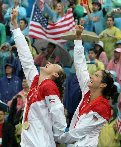 Misty May-Treanor (right) of the U.S. celebrates with her teammate Kerri Walsh during the podium ceremony after winning against China's Tian Jia and Wang Jie in their women's final beach volleyball match at Beijing's Chaoyang Park Beach Volleyball Ground on August 21, 2008 during the 2008 Beijing Olympic Games. Photo: THOMAS COEX, AFP/Getty Images