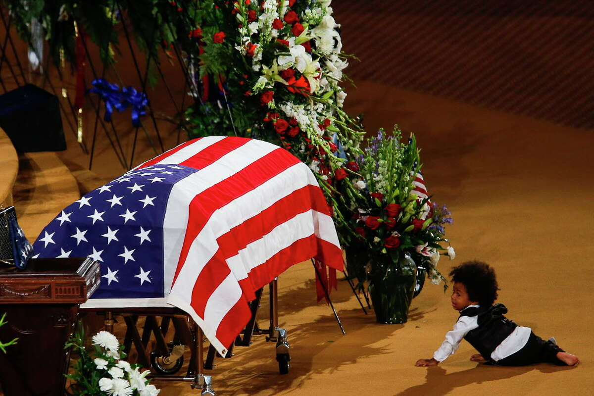 Julian Ekpanya, son of fallen Pearland police officer Endy Ekpanya, cries next to his coffin during a funeral service at Grace Community Church Tuesday, June 21, 2016 in Houston.