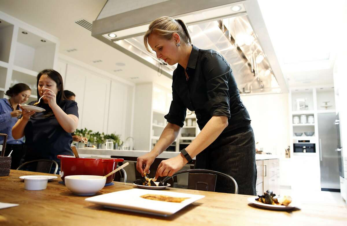 Amanda Haas, culinary director for Williams-Sonoma, prepares a plate during a food tasting in the test kitchen at Williams-Sonoma in San Francisco, California, on Monday, June 20, 2016.