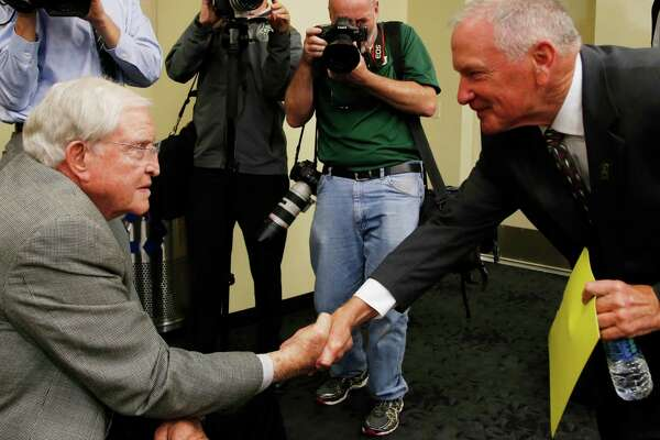 Baylor interim head football coach Jim Grobe, right, shakes hands with Grant Teaff, who coached Baylor in the 1970s, following a news conference. A reader criticizes donors who want to bring back Art Briles, the coach who was fired in the wake of a rape scandal at the university.