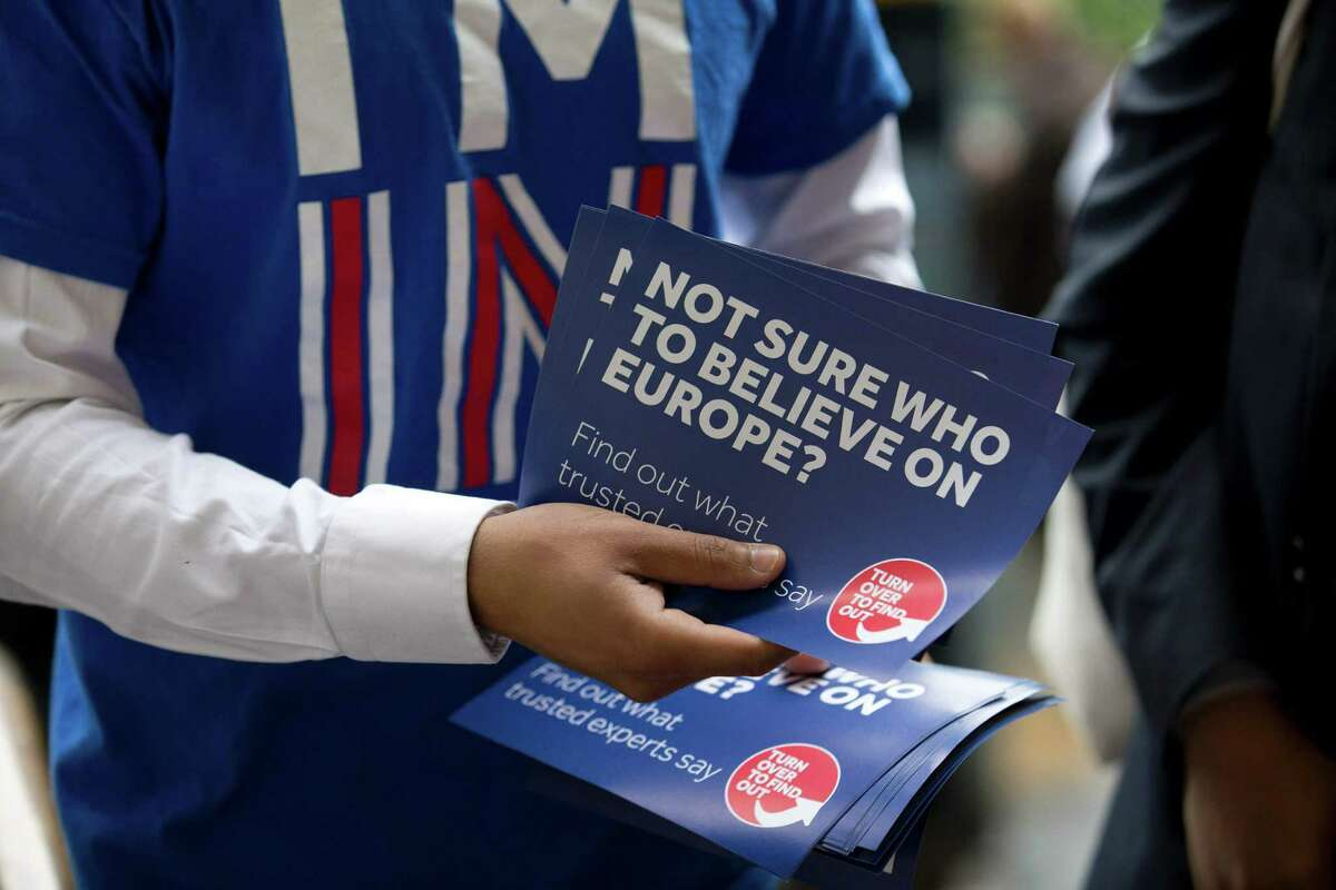A campaigner hands out leaflets for the official campaign group seeking to avoid a Brexit - the departure of Britain from the European Union. Many supporters of leaving the EU concede that a slowdown could follow, but for most of them, that's not the point.