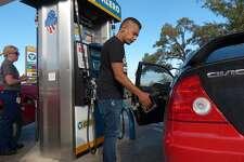 Charles Flores pumps gas at the Valero Station at 5602 UTSA Blvd on Friday, Oct. 31, 2014.