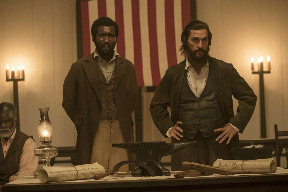 """Mahershala Ali, left, and Matthew McConaughey in a scene from """"The Free State of Jones."""" Photo: Murray Close, Associated Press"""