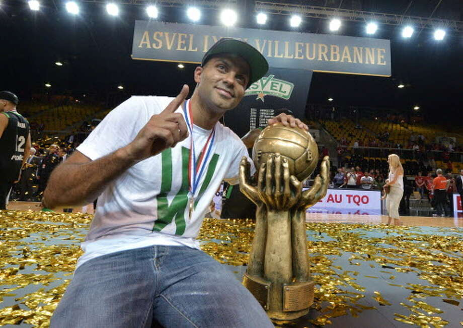 ASVEL's owner Tony Parker poses with the trophy at the end of the Pro A basketball game 5 of the final match between Strasbourg (SIG) and Villeurbanne (ASVEL) on June 14, 2016 in Strasbourg, eastern France.    / AFP PHOTO / PATRICK HERTZOGPATRICK HERTZOG/AFP/Getty Images Photo: PATRICK HERTZOG/AFP/Getty Images