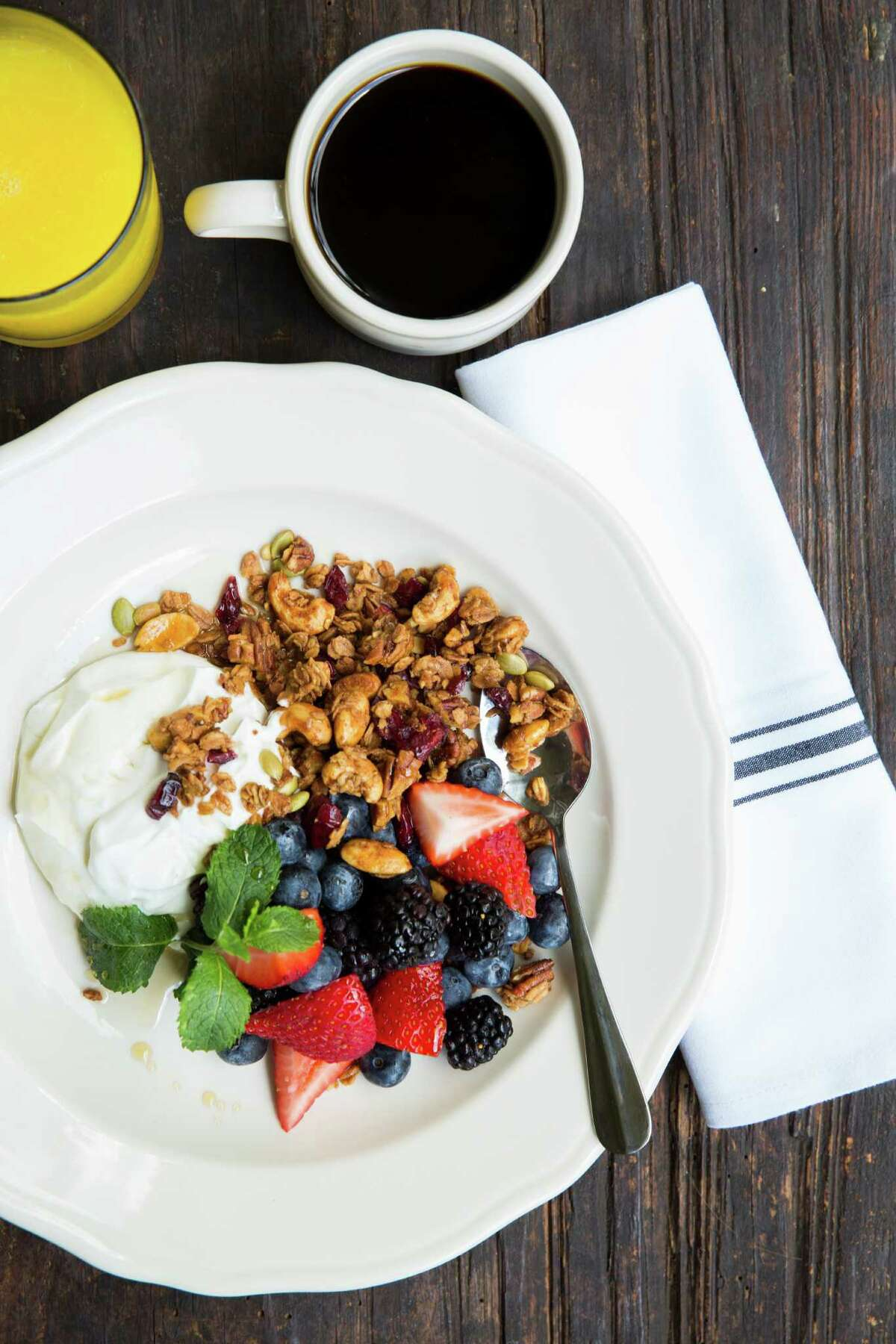Relish Restaurant & Bar, the second enterprise from the owners of Relish Fine Foods, is scheduled to open early August 2016 at 2810 Westheimer in the former the Bird & the Bear location. Shown: Homemade granola with Greek yogurt and berries.