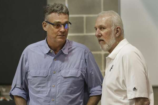 R.C. Buford, left, and Gregg Popovich chat during the San Antonio Spurs media day at their practice facility. Friday, Sept. 26, 2014.